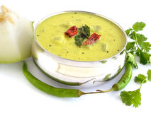 Ash gourd curry. Curry, in a steel bowl, made from ash gourd and yogurt Royalty Free Stock Photography