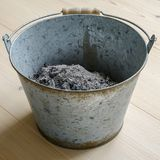 Ash in a metal bucket stock photography