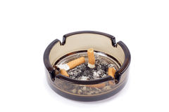 Ash-tray. A flithy glass ash-tray, photo on the white background Royalty Free Stock Photography