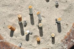 Ash Tray Cigarettes Sand Outdoor Stock Photo