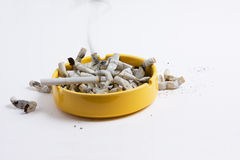 Ash tray full of butts Royalty Free Stock Photos