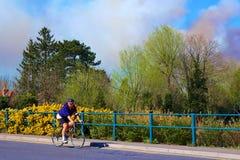 Ash Vale and bike rider, Hampshire, UK Royalty Free Stock Image