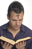 Ash Wednesday. Ashes on man's forehead as he reads Bible Royalty Free Stock Photography