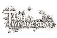 Ash Wednesday word written in ash, sand or dust. As christian religion holiday before lent, cross or crucifix symbol of Jesus Christ, fasting, abstinence, death Royalty Free Stock Images