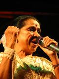 Asha. The legendary Indian singer Asha Bhosale in a performance. She is one of the most versatile singers and holds a record for having recording highest number Royalty Free Stock Image