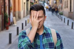 Ashamed man covering his face stock image