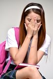 Ashamed School Girl Wearing School Uniform With Books