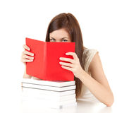 Ashamed student girl covering face book Royalty Free Stock Photo