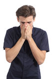Ashamed or worried man covering mouth with his hands Royalty Free Stock Image