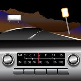Ashboard Radio AM FM Highway Drive Background. Dashboard Auto Radio AM FM Drive Time Background. On a dark desert highway Royalty Free Stock Photo