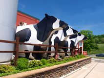 Ashe County Cheese Factory. Three large, metal cows guard the entrance to the Ashe County Cheese Factory in West Jefferson, North Carolina Stock Photos
