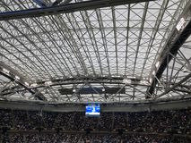 Ashe Stadium - US Open Tennis. A crowded Arthur Ashe Stadium, under a closed roof, for a 2017 U.S. Open tennis match, Nadal vs. Rublev Royalty Free Stock Images