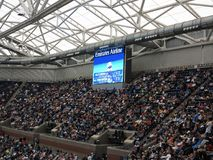 Ashe Stadium - US Open Tennis. A crowded Arthur Ashe Stadium, under a closed roof, for a 2017 U.S. Open tennis match, Vandeweghe vs. Pliskova Royalty Free Stock Photo