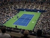 Ashe Stadium - US Open Tennis. A crowded Arthur Ashe Stadium, under a closed roof, for a 2017 U.S. Open tennis match, Vandeweghe vs. Pliskova Royalty Free Stock Images
