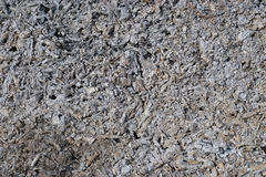 Ashes and pieces of coals background Royalty Free Stock Image