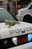 Asheville NC Police car in rain with flowers during Woman`s March. Vertical view in downtown  Asheville NC January 21st 2017 Women`s March of Police car with Stock Photos