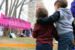 Asheville NC Women March Banner with children Hugging. Horizontal view in downtown  Asheville NC January 21st 2017 Women`s March banner with  Children hugging Royalty Free Stock Photos