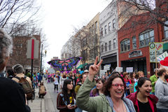 Asheville NC Women March. Horizontal view in downtown street full of people marching in rain during Womens` March on Asheville NC January 21st 2017 Royalty Free Stock Photos
