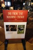 ASHEVILLE, NORTH CAROLINA - MARCH 4, 2017: Biltmore`s costume exhibition. `Far from the Madding Crowd` poster details the costume`s origin, designer and who Stock Photography