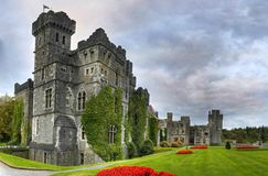 Ashford castle and gardens. Ashford castle hotel with gardens panoramic Royalty Free Stock Image