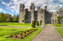 Ashford castle HDR. 13th Century Ashford castle and gardens - Co. Mayo - Ireland Royalty Free Stock Photography