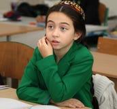 Ashgabad,土库曼斯坦- 2014年11月4日 一个未知的学校女孩的画象 免版税库存照片