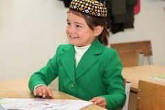 Ashgabad,土库曼斯坦- 2014年11月4日 一位未知的女小学生的画象 库存图片