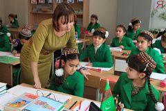 Ashgabad, Turkmenistan - November 4, 2014. Group of students wit stock photos