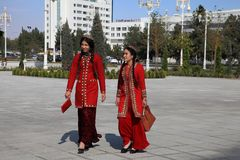 Ashgabad, Turkmenistan - October 10, 2014. Two young girls in na Royalty Free Stock Photography