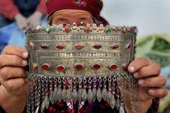Ashgabat, Turkmenistan - March 09.  Portrait of old unidentified. Asian woman. W oman with silver national Turkmen ornament. Oriental bazaar.  Ashgabat Royalty Free Stock Image