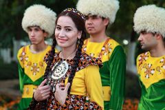 Ashgabat, Turkmenistan - May 25, 2017: Group of students in na. Tional dress on outdoor. Ashgabat, Turkmenistan, May 25, 2017. Ashgabat is the capital of royalty free stock photos