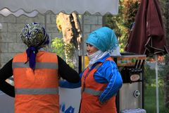 Ashgabat, Turkmenistan - October 26, 2014.  Women clean the stre Stock Image