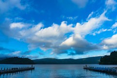 Ashi lake berth, pier with mountains on the background stock images