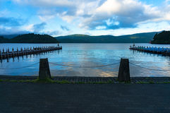Ashi lake berth, pier with mountains on the background royalty free stock image