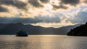 Ashi lake with sun rays, Hakone Royalty Free Stock Photos