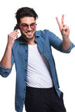 Ashion man showing the victory sign Stock Image