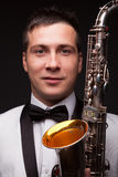 Ashionable man with sax. Closeup of fashionable man with sax. Modern musician Royalty Free Stock Images