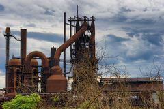 Ashland Kentucky Steel Mill under cloudy skies. Evening light and cloudy skies enhanced this old Steel Mill in Ashland, Kentucky royalty free stock images