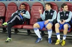 Ashley Cole, Cesar Azpilicueta and Juan Mata. Chelsea London players Ashley Cole, Cesar Azpilicueta and Juan Mata react on the substitutes bench during the Stock Images