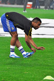 Ashley Cole stretches to warm up Royalty Free Stock Images