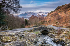 Ashness Bridge and snow capped Skiddaw Royalty Free Stock Photography