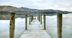 Ashness Jetty. Calm day at Ashness Jetty on Derwentwater stock image