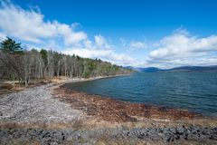 Ashokan Reservoir in New York State on a Beautiful Spring Morning. Shoreline and Distant Mountains at the Ashokan Reservoir. Beautiful Spring Morning, Blue Sky royalty free stock images