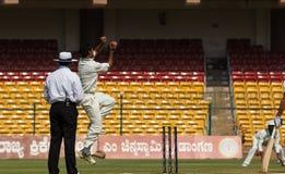 Ashoke Dinda bowling. Ashoke Dinda jumps at his run up before delivering the ball royalty free stock image