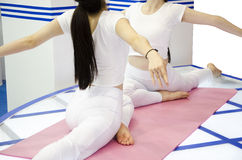 Ashtanga Yoga. Two girls are doing Ashtanga Yoga stock image