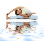 Ashtanga yoga on white sand. Lovely girl practicing ashtanga yoga on white sand stock photos