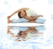 Ashtanga yoga on white sand. Lovely girl practicing ashtanga yoga on white sand stock images
