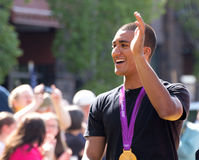Ashton Eaton Olympian Waving to Homecoming Crowd. Ashton Eaton, Olympic gold medal decathlon winner waving to the crowd at his homecoming parade celebration in Royalty Free Stock Images