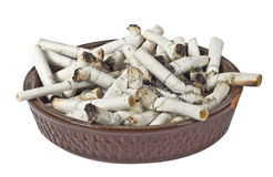 Ashtray. Full of disgusting stubs isolated on a white background Stock Image