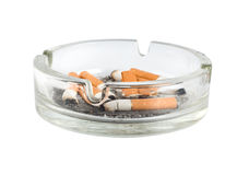 Ashtray. Cigarettes in an ashtray isolated on white background Royalty Free Stock Photo
